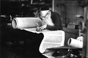 sofer restoring Torah scroll